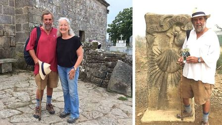 Journey's end: Peter Harris (right) at the outskirts of Santiago and )left) with Liz Sayers who also