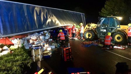 Three people suffered minor injuries after a lorry rolled onto a car on the A141 Isle of Ely Way. Pi