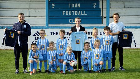 Ellie Chapman, Chatteris Aldi area manager, presents new kit to Chatteris Town Football Club. With U