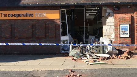 St Ives Co-op was targeted at just after 3am and stole a cash machine before leaving in a grey Audi