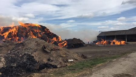 Firefighters tackling a blaze between Manea and Chatteris involving around 300 tonnes of straw and w
