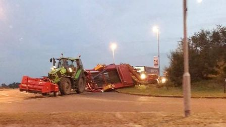 A tractor overturned on the A142 in Chatteris on October 17. Picture: TASH SCOTT