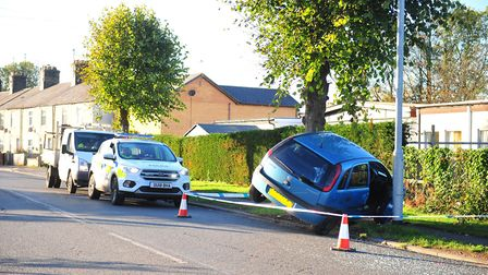 The scene on Upwell Road after a blue Corsa wedged itself between a tree and a lamppost. Picture(s):