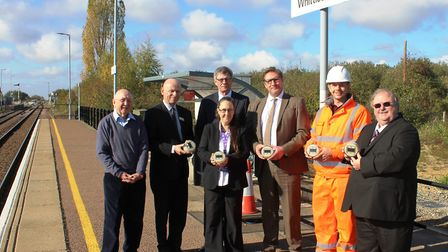 Welcoming the new solar powered lights at Whittlesea Station are, back row from left, Cllr Alan Bris