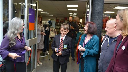 Soham's super fundraiser Liam Johnson, 12, cut the ribbon to open Ely High Street's new EACH charity