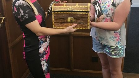 Danelle Hearing presenting Ruby Mason-Hughes with her Chocolate Bounty. Picture: SUBMITTED
