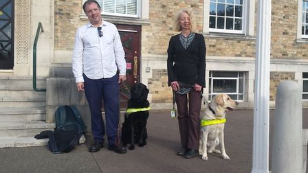 Michael Wordingham and his dog Mac with Lynn Hester and Saffron outside Shire Hall earlier. Picture: