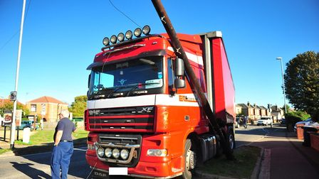 A lorry has crashed into a telephone pole outside the Men of March pub this afternoon (Tuesday, Octo