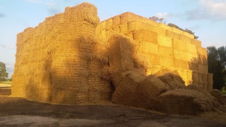 The fire at Stretham on Friday October 5: How the stack was in August before the blaze. Arrests hav