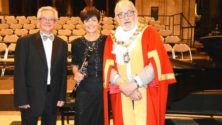 Conductor Andrew Parnell, clarinet player Koren Wilmer and Mayor of Ely, Cllr Mike Rouse.