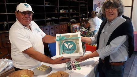 Stephen Cole and a special Timebank cake at the Littleport and Ely charity event