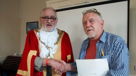 One of the winners of the short story competition, Roger Rix (right) and the Mayor of Ely, Councillo
