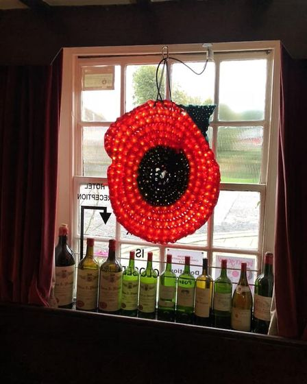 Illuminated poppy at the Cross Keys in Chatteris to commemorate the 100th anniversary of the end of