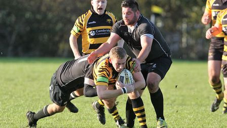 Ely narrowly lose at home against top of the league Holt. Ryan Clark gets tackled. Picture: STEVE WE