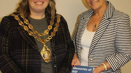 Cllr Elaine Griffin-Singh, with Sue Aldridge and the book Memories of RAF Witchford.