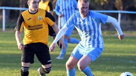 Chatteris Town man Ash Blanchflower holds off March Town Reserves player Luke Cable during their cup