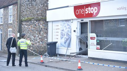 Police officers at the scene of the ram raid in Feltwell. Picture: Ian Burt