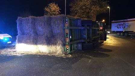 A trailer carrying hay bales overturned on Peas Hill roundabout at the junction of Wisbech Road just