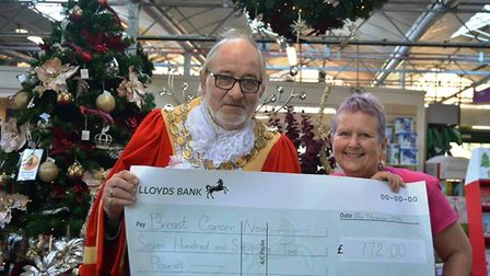 Mayor of Ely Councillor Mike Rouse presenting a cheque for £772 to Debbie Hitchings. The money was r