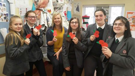 Ely College remembers with hundreds of handmade poppies as the Last Post is sounded. Picture: KERRI