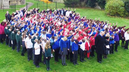 Three hundred Whittlesey pupils form field of poppies outside church to mark the100th anniversary of