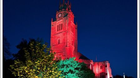 Sutton's church was lit, in red, to salute and remember those who fought and fell, as well as those