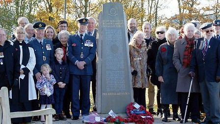 RAF Witchford Remembrance Sunday service and wreath laying. The group is pictured around the 115 Squ