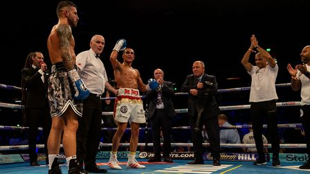 Jordan Gill (centre) celebrates victory against Ryan Doyle in the Commonwealth Featherweight Champio