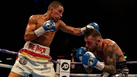 Ryan Doyle (right) against Jordan Gill in the Commonwealth Featherweight Championship at The Copper
