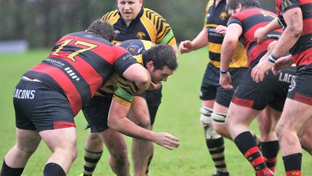 Ely Tigers v Wynmondham. Mitchell Kennett looks for a way past. Picture: STEVE WELLS.