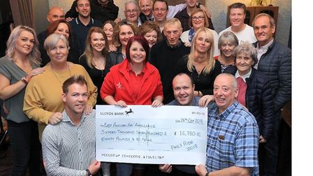 Pictured (holding the cheque, from left to right): Sean Whyman (Old White Bell Landlord), Amy Haynes