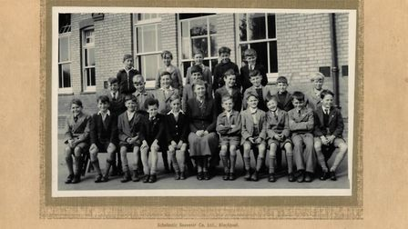 Tony King, who is pictured fourth from the left on the front row, is looking to trace any of his for