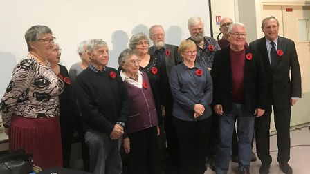 Poppies knitted by a stalwart member of the Little Downham book club were transported overseas to be