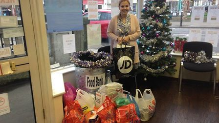 Help Holiday With Us to fill their charity Christmas hampers with food, toys and toiletries
