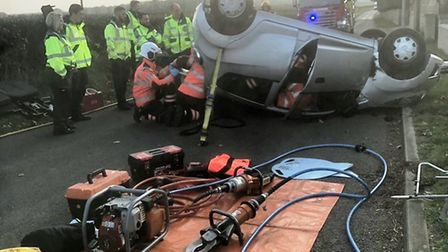 A woman overturned her car after being 'blinded by the sun' in Cambridgeshire yesterday afternoon (N