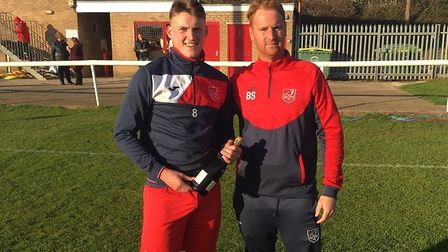 Ely City boss Brady Stone (right) presents the club's October player-of-the-month award to Joe Brann