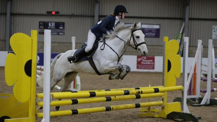 A King's Ely pupil in showjumping action