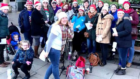 Rock Vox Choir raise hundreds for charity by carol singing around Ely ahead of Christmas concert in