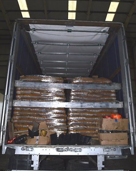 Two lorry drivers, who tried to smuggle more than 1.5 million cigarettes into the UK hidden between