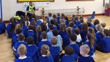 East Cambridgeshire PCSOs visiting a Littleport primary school earlier this year about the role of p