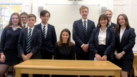Debate success at King's Ely. MP Lucy Frazer with students. Picture: KING'S ELY