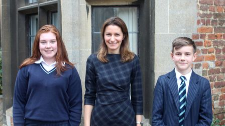 Debate success at King's Ely. MP Lucy Frazer with winners George Collier and Mia Gray. Picture: KING
