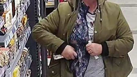 Caught on camera: CCTV shows woman 'stealing 50p tins of Dolmio sauce' from Nisa store in Victory Av