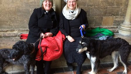 Canon Vicky Johnson with her labradoodle, Percy (left) and Canon Jessica Martin with her rescue dog,