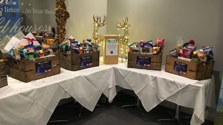Hampers stocked with Christmas goodies raffled off at Celebration of Business event in Ely. Business