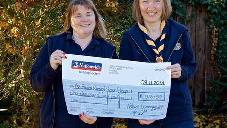 Nellie's community café in Sutton donates more than £1,000 to local charity 1st Sutton Scout Group.
