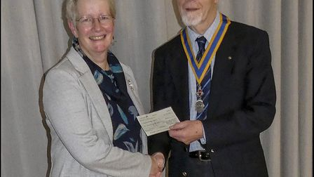 March Rotary Club president Alan Burdass giving a cheque donation to Barbara Taylor, co-ordinator of