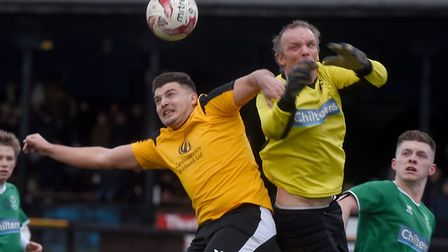 Recent March Town recruit Danny Emmington challenges the Lakenheath goalkeeper. Picture: IAN CARTER