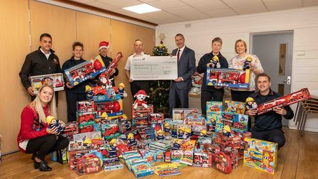 Staff with the toys they bought thanks to the donation - Cambridgeshire Fire and Rescue received a s