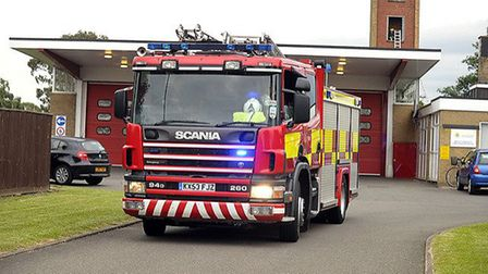 Cambridgeshire Fire crew tackle a blaze in a chimney at a March home